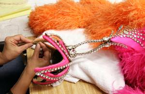 Wardrobe technician Shahnaz Minaian repairs a headpiece inside the Jubilee! costume shop at Bally's in Las Vegas on Tuesday, June 11, 2013.