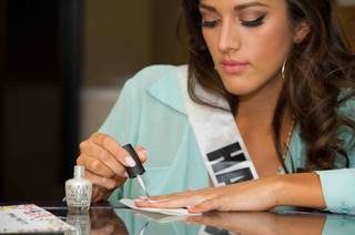 Miss Hawaii USA 2013, Brianna Acostai paints her nails with one of the OPI nail lacquers she received as a sponsor gift, while on a break from rehearsal at Planet Hollywood Resort and Casino in Las Vegas, Nevada on Tuesday June 11, 2013.  She will spend the next week touring, filming, rehearsing, and making new friends while preparing to compete for the coveted Miss USA Diamond Nexus Crown. Tune in to the crowning moment LIVE on NBC starting at 9:00 PM ET on June 16th, 2013 from PH Live. HO/Miss Universe Organization L.P., LLLP.