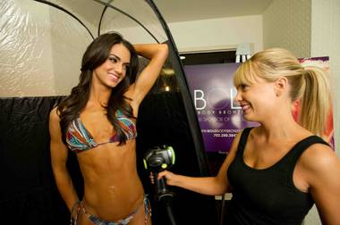 Miss Maryland USA 2013, Kasey Staniszewski, gets a spray tan from Kamela Brewer of Bold Body Bronzing while on a break from rehearsal at Planet Hollywood Resort and Casino in Las Vegas, Nevada on Tuesday June 11, 2013.  She will spend the next week touring, filming, rehearsing, and making new friends while preparing to compete for the coveted Miss USA Diamond Nexus Crown. Tune in to the crowning moment LIVE on NBC starting at 9:00 PM ET on June 16th, 2013 from PH Live. HO/Miss Universe Organization L.P., LLLP.