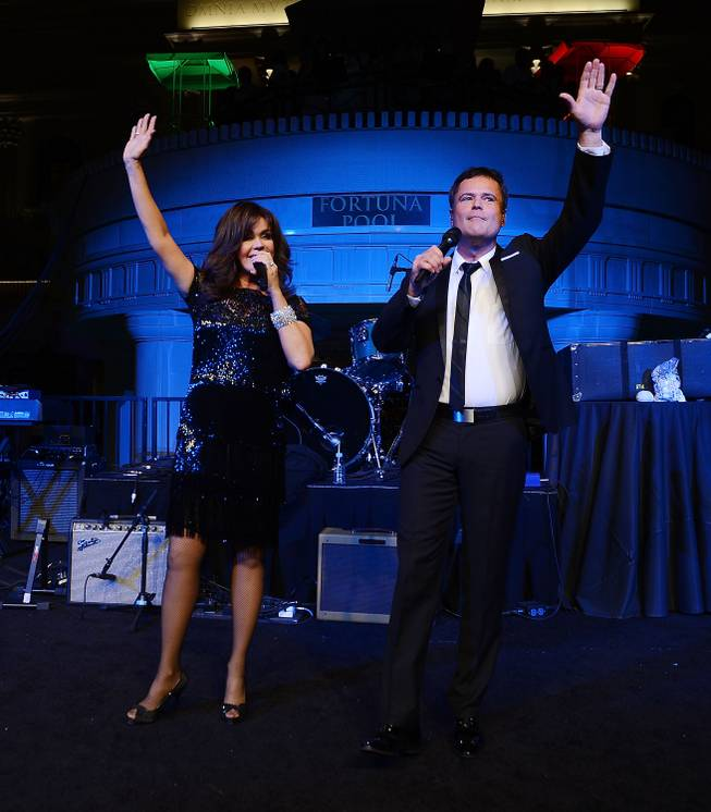 Flamingo Las Vegas headliners Donny & Marie Osmond perform at the closing-night party for IPW 2013 at the Garden for the Gods pool at Caesars Palace on June 12, 2013.