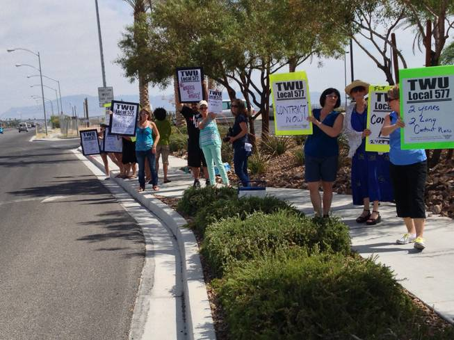 Members of the Transportation Workers Union protest on the second anniversary of the start of negotiations for a contract for Allegiant Air flight attendants in front of the airline's headquarters in Las Vegas.