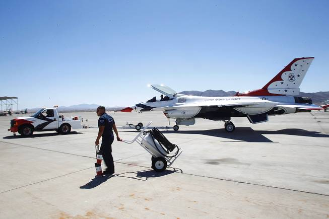 A Thunderbird F-16 is towed to its hangar June 13, 2013 at Nellis Air Force Base.