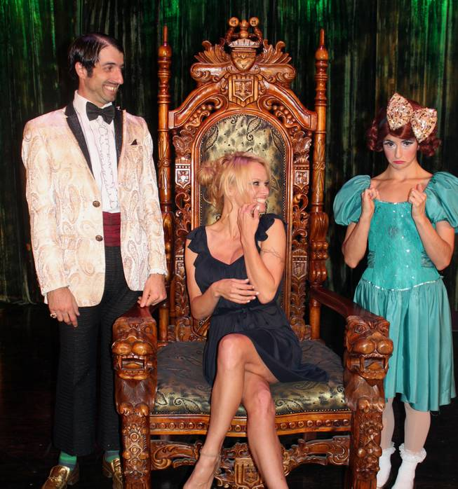 "Pamela Anderson checks out ""Absinthe."" The Gazillionaire and Penny Pibbets are pictured with Anderson."