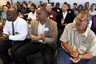 Graduates applaud during the Hope for Prisoners graduation ceremony in Las Vegas on Friday, June 14, 2013. Hope for Prisoners provides intensive one week training for prisoners reentering society.