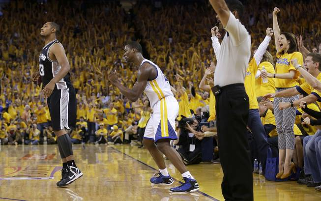 Golden State Warriors forward Harrison Barnes, center, celebrates next to San Antonio Spurs center Boris Diaw after scoring during the third quarter of Game 4 of a Western Conference semifinal NBA basketball playoff series in Oakland, Calif., Sunday, May 12, 2013. The Warriors won 97-87 in overtime. Barnes had 26 points and 10 rebounds.