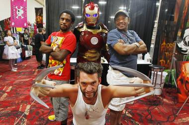 Jamaal Hardy, left, and Gus Hardy pose with characters Ross Johnson, dressed as Wolverine, and Daniel Castro, dressed as Iron Man, at the Amazing Las Vegas Comic Con at the South Point Saturday, June 15, 2013.