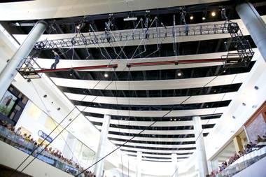 Criss Angel leaps across two separate steel beams five stories high inside Fashion Show Mall on the Las Vegas Strip, Saturday, June 15, 2013.