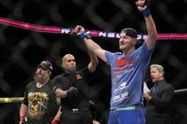 Stipe Miocic celebrates his heavyweight victory over Roy Nelson during UFC 161 in Winnipeg, Manitoba on Saturday June 15, 2013