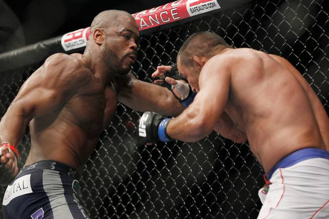 Rashad Evans backs Dan Henderson into a corner during UFC 161 in Winnipeg, Manitoba on Saturday June 15, 2013.
