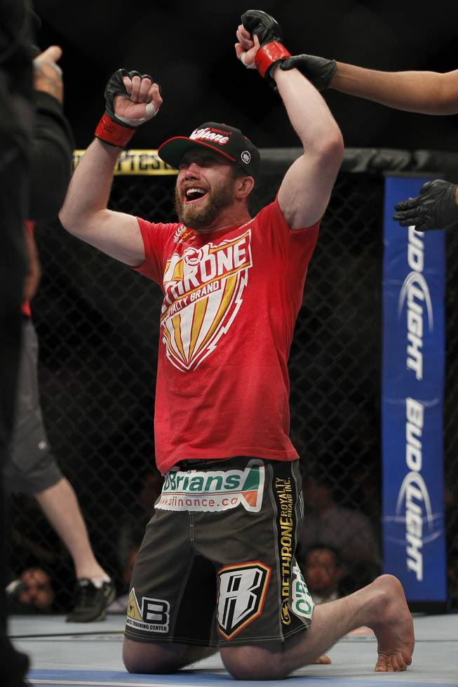 Mitch Clarke celebrates his win over John Maguire in a lightweight bout during UFC 161 in Winnipeg on Saturday June 15, 2013.