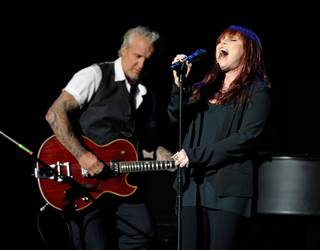 Guitarist Neil Giraldo (L) and singer Pat Benatar perform at The Pearl concert theater at the Palms Casino Resort on June 15, 2013 in Las Vegas.