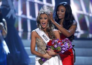 Miss Connecticut Erin Brady reacts as she is crowned by Miss USA 2012 Nana Meriwether during the Miss USA pageant at Planet Hollywood Sunday, June 16, 2013.