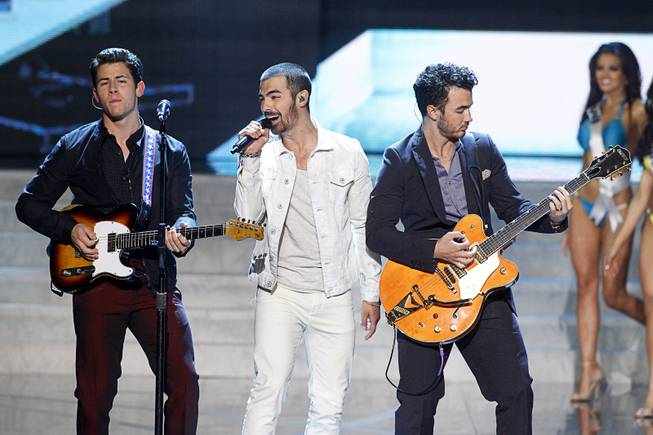 Nick Jonas (L), Joe Jonas (C) and Kevin Jonas of the Jonas Brothers perform during the Miss USA pageant at Planet Hollywood Sunday, June 16, 2013.