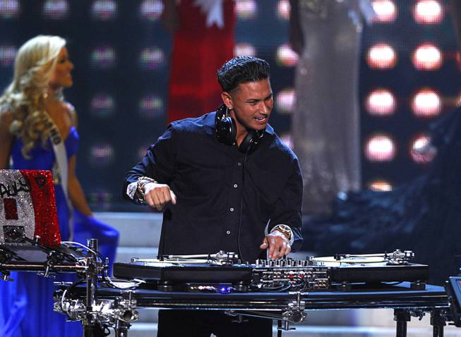 DJ Pauly D performs during the Miss USA pageant at Planet Hollywood Sunday, June 16, 2013.