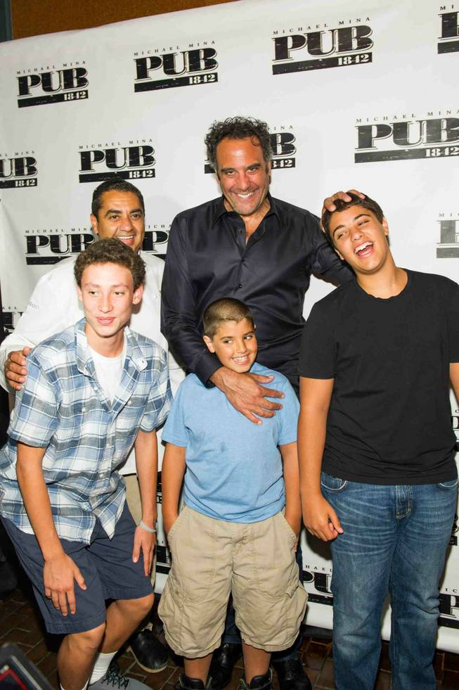Michael Mina, back left, with Brad Garrett at the opening celebration of Michael Mina's new Pub 1982 at MGM Grand, Monday, June 17, 2013.