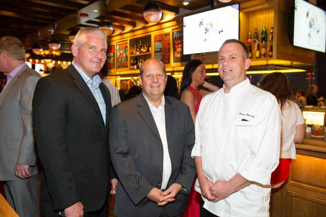 Charles Govan,left, Daniel Adams, center, Russ Hurry at the opening celebration of Michael Mina's new Pub 1982 at MGM Grand, Monday, June 17, 2013.