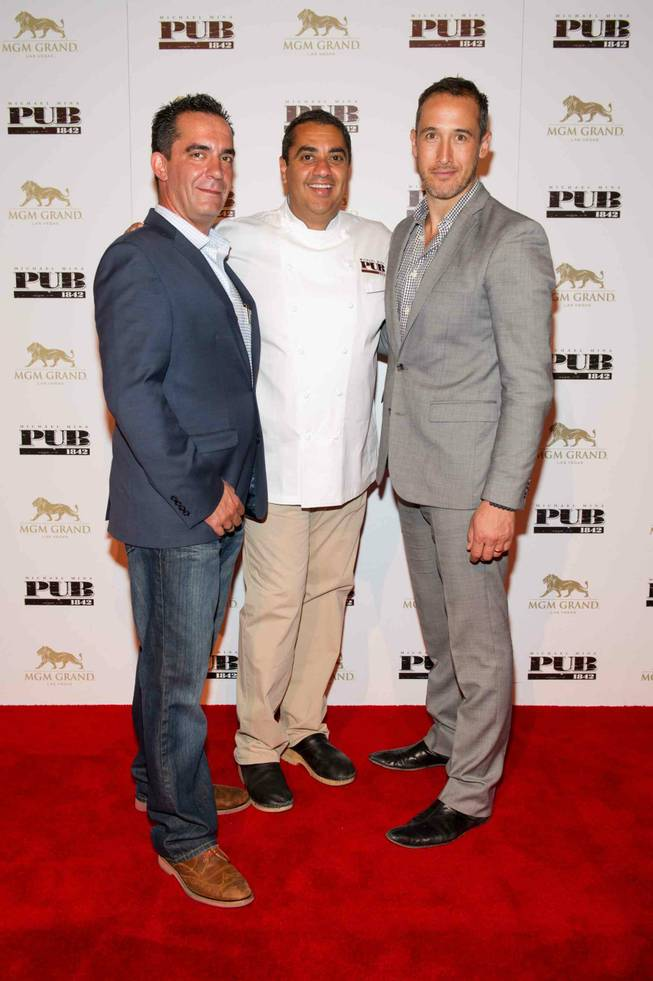 Ed Tracy, Michael Mina and Patric Yumul at the opening celebration of Mina's Pub 1982 at MGM Grand on Monday, June 17, 2013.