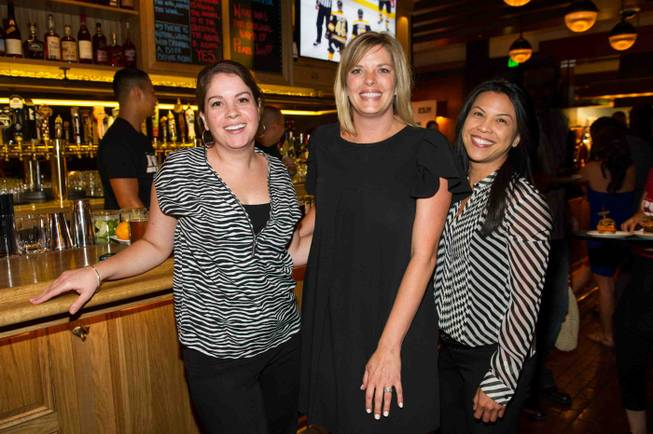 Kate Wik,left, Jessica Cipollo, center, and Lindsay Aguilar at the opening celebration of Michael Mina's new Pub 1982 at MGM Grand, Monday, June 17, 2013.