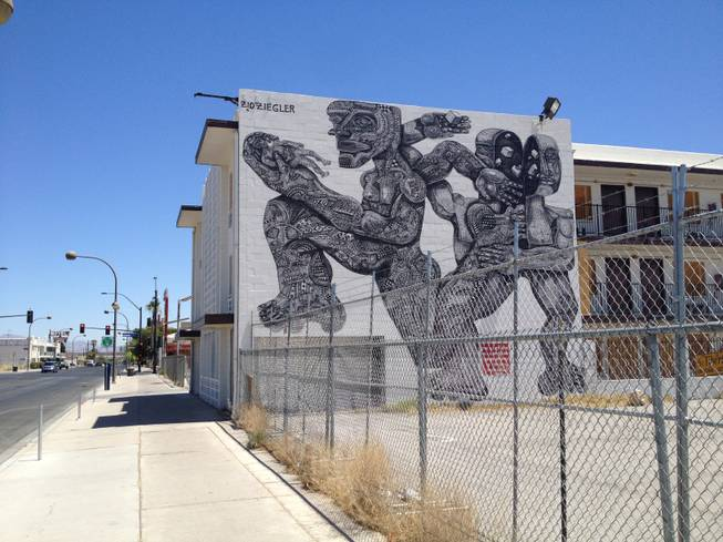 Zio Ziegler, a San Francisco-based muralist, created this mural on the back wall of the Western hotel.