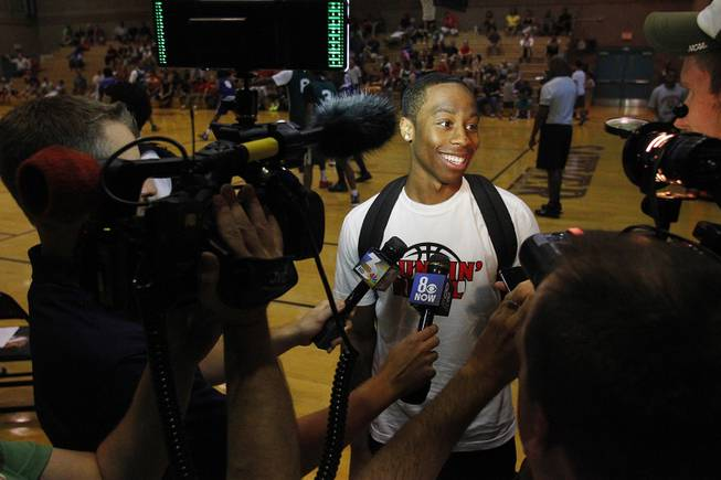 UNLV transfer Kevin Olekaibe talks to the media before his  game on the first night of the Desert Reign tournament Tuesday, June 18, 2013.