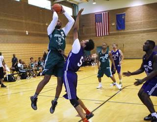 Jelan Kendrick shoots over Rashaad Muhammad during their game on the first night of the Desert Reign tournament Tuesday, June 18, 2013.