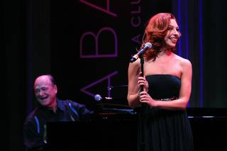 Tara Palsha accompanied by Bill Fayne, sings during a performance of the Broadway-based open mic and variety show Cast Party Wednesday, June 19, 2013 at Cabaret Jazz at the Smith Center.