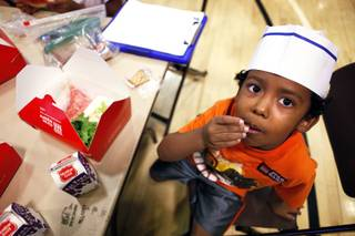 Dallas Spears, 5, eats his lunch during the Summer Food Service Program at the Heinrich YMCA in Las Vegas on Wednesday, June 19, 2013. The Summer Food Service Program is a federal nutrition program designed to feed children free, nutritious meals and snacks during the months of June, July, and August when school is out.