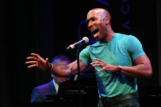 Eric Jordan Young sings during a performance of the Broadway-based open mic and variety show Cast Party on Wednesday, June 19, 2013, at Cabaret Jazz in the Smith Center.