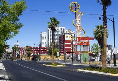 The Ambassador East Motel sign, right, is shown on East Fremont Street Wednesday, June 20, 2013. The motel was demolished in 2007 but the sign is being refurbished in time for the inaugural Life is Beautiful festival.