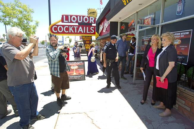 Mayor Carolyn Goodman poses for a photo with Kathleen Frantz, development director for the National Atomic Testing Museum, during the grand reopening of The Atomic on East Fremont Street Wednesday, June 20, 2013. The bar was originally built in 1945 as Virginia's Cafe but was renamed Atomic Liquors in 1952 when patrons used to go to the roof to watch the nuclear blasts from the Atomic Test Site.