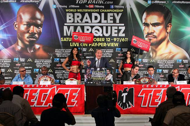 June 20, 2013,Beverly Hills,Ca.    ---  Hall of Fame Top Rank promoter Bob Arum speaks -- (L-R) Undefeated WBO welterweight champion Timothy Bradley and four-division champion Juan Manuel Marquez during the press conference at the Beverly Hills Hotel to announce their upcoming Oct. 12 championship fight at the Thomas & Mack Center in Las Vegas, Nevada.   .Chris Farina - Top Rank.