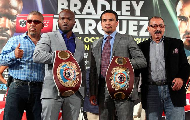 June 20, 2013,Beverly Hills,Ca.    --- Trainers: Joel Diaz, Nacho Beristan -- (L-R) Undefeated WBO welterweight champion Timothy Bradley and four-division champion Juan Manuel Marquez during the press conference at the Beverly Hills Hotel to announce their upcoming Oct. 12 championship fight at the Thomas & Mack Center in Las Vegas, Nevada.   .Chris Farina - Top Rank.