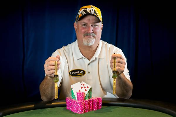 "Tom ""The Donkey Bomber"" Schneider poses with the two HORSE bracelets he's won at the 2013 World Series of Poker on June 16 2013."
