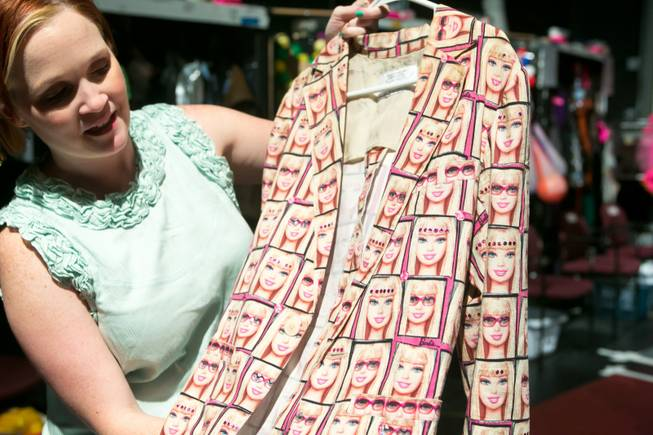 "Gillian Austin, wardrobe supervisor for the new ""Priscilla Queen of the Desert"" show, holds up a ""Barbie"" blazer used in the show, as seen Thursday, June 20, 2013."