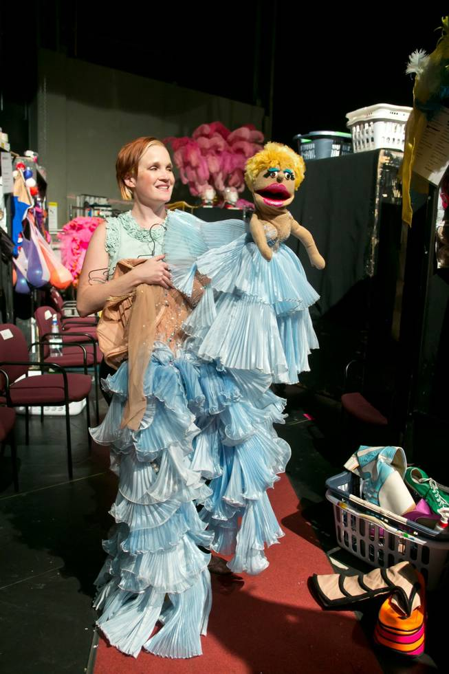 "Gillian Austin, wardrobe supervisor for the new ""Priscilla Queen of the Desert"" show, holds up an intricate ""Puppet"" dress used in the show, as seen Thursday, June 20, 2013."