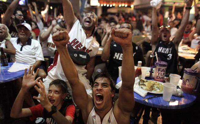 Miami Heat fans react while watching Game 7 of the NBA Finals between the Heat and the San Antonio Spurs in Miami, on Thursday, June 20, 2013.
