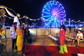 Brian Mills officiates as Shacura and Charles Mendoza exchange wedding vows during the first night of the Electric Daisy Carnival Friday, June 21, 2013 at the Las Vegas Motor Speedway.