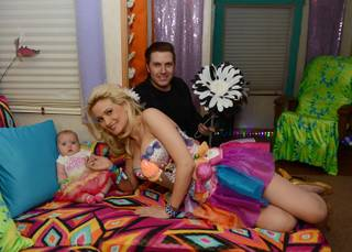 Rainbow Aurora Rotella, Holly Madison and Pasquale Rotella before the 17th annual Electric Daisy Carnival at Las Vegas Motor Speedway on Friday, June 21, 2013.