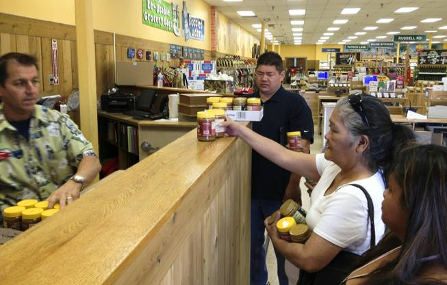 Shoppers pick up jars of the popular Speculoos Cookie Butter from the.manager's counter at Trader Joe's on Green Valley Parkway, June 21, 2013. At this and other Trader Joe's, the cookie butter is kept there to prevent people from rushing the aisles.