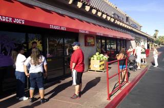 Shoppers wait outside Trader Joe's on Green Valley Parkway on June 21, 2013, shortly before its 8 am opening. At least four people were there to buy the popular Speculoos Cookie Butter.