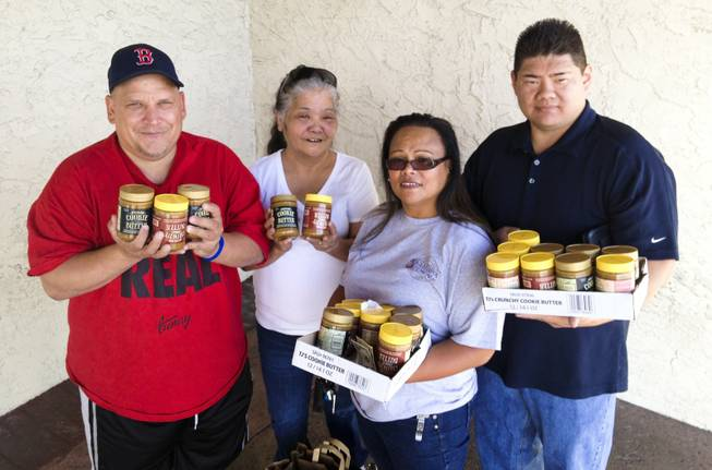 "From left, Las Vegas Valley residents Eric Clay, Charlene Arellano, Rochelle Jiminez and Ricardo ""Rico"" Unzueta pose for a photo outside Trader Joe's on Green Valley Parkway June 21, 2013, holding jars of the popular Speculoos Cookie Butter they had just bought from the store."