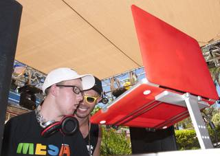 Colorado teen Tanner Seebaum, left, is given props by DJ Landon Dykesterhouse as he plays music for the weekend revelers at Rehab. Seebaum was diagnosed with an inoperable brain tumor and has battled cancer most of his life, and was granted a special wish to be a DJ by the Hard Rock Hotel on Saturday afternoon.