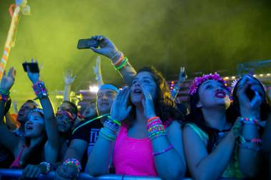 Festival goers watch as Empire of the Sun performs during night 2 of the Electric Daisy Carnival, Saturday June 22, 2013.