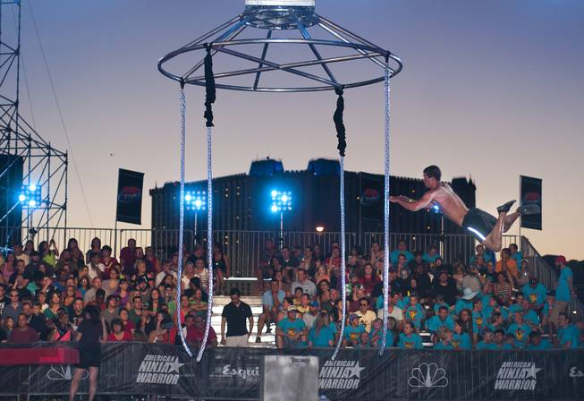 "A trial run is attempted on an obstacle as friends and family of competitors gather in the audience before shooting Season 5 of ""American Ninja Warrior"" on Saturday, June 22, 2013, near the Strip."