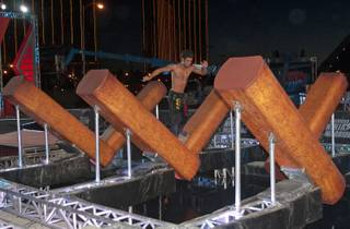 "An athlete has a run at one of the obstacles on the set of Season 5 of ""American Ninja Warrior"" on Saturday, June 22, 2013, near the Strip."