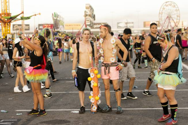 Fans look around and take pictures at the end of day two of the Electric Daisy Carnival Festival, EDC, at the Las Vegas Motor Speedway, Sunday morning, June 23, 2013.