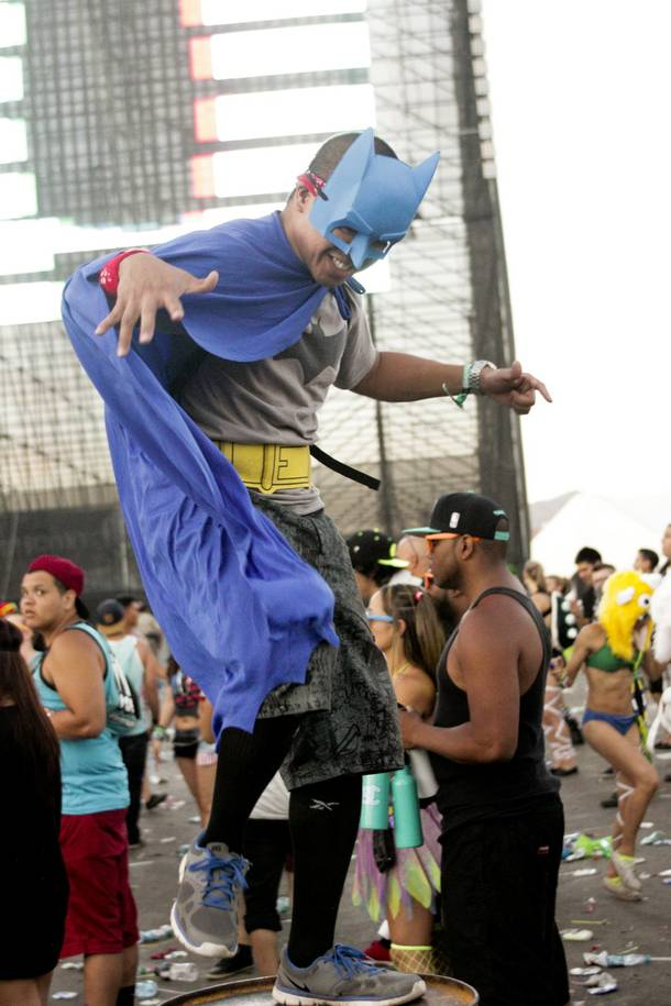 A fan dances on a barrel during the Headhunterz set at the Electric Daisy Carnival Festival, EDC, at the Las Vegas Motor Speedway, Sunday morning, June 23, 2013.