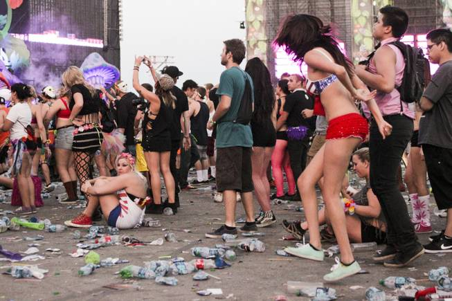A fan sits down during the last act of the day, Headhunterz, at the Electric Daisy Carnival Festival, EDC, at the Las Vegas Motor Speedway, Sunday morning, June 23, 2013.