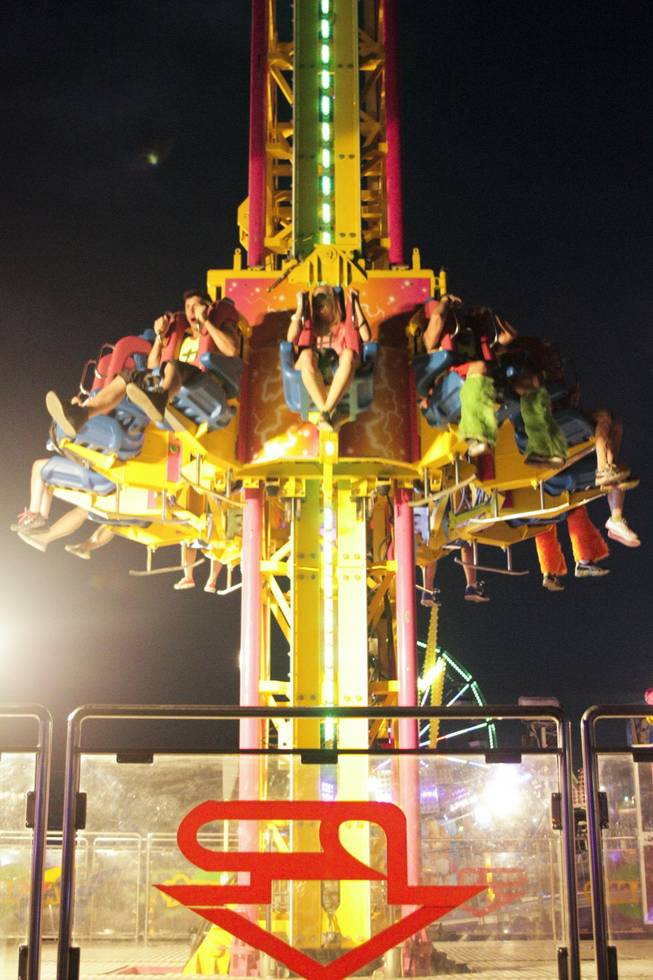 Festival attendees ride the Mega Drop at the Electric Daisy Carnival Festival, EDC, at the Las Vegas Motor Speedway, Sunday morning, June 23, 2013.