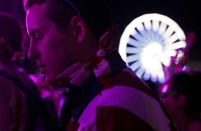 A fan closes his eyes while enjoying the Benny Benassi set at the Electric Daisy Carnival Festival, EDC, at the Las Vegas Motor Speedway, Sunday morning, June 23, 2013.